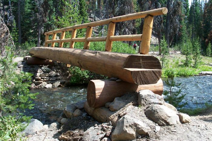 usfs trail crew builds a log bridge over fall creek at green lakes trail head. Black Bedroom Furniture Sets. Home Design Ideas
